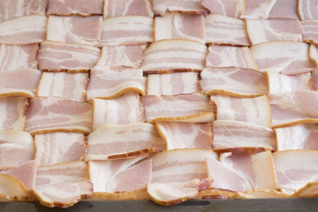 First you weave the bacon on a tray
